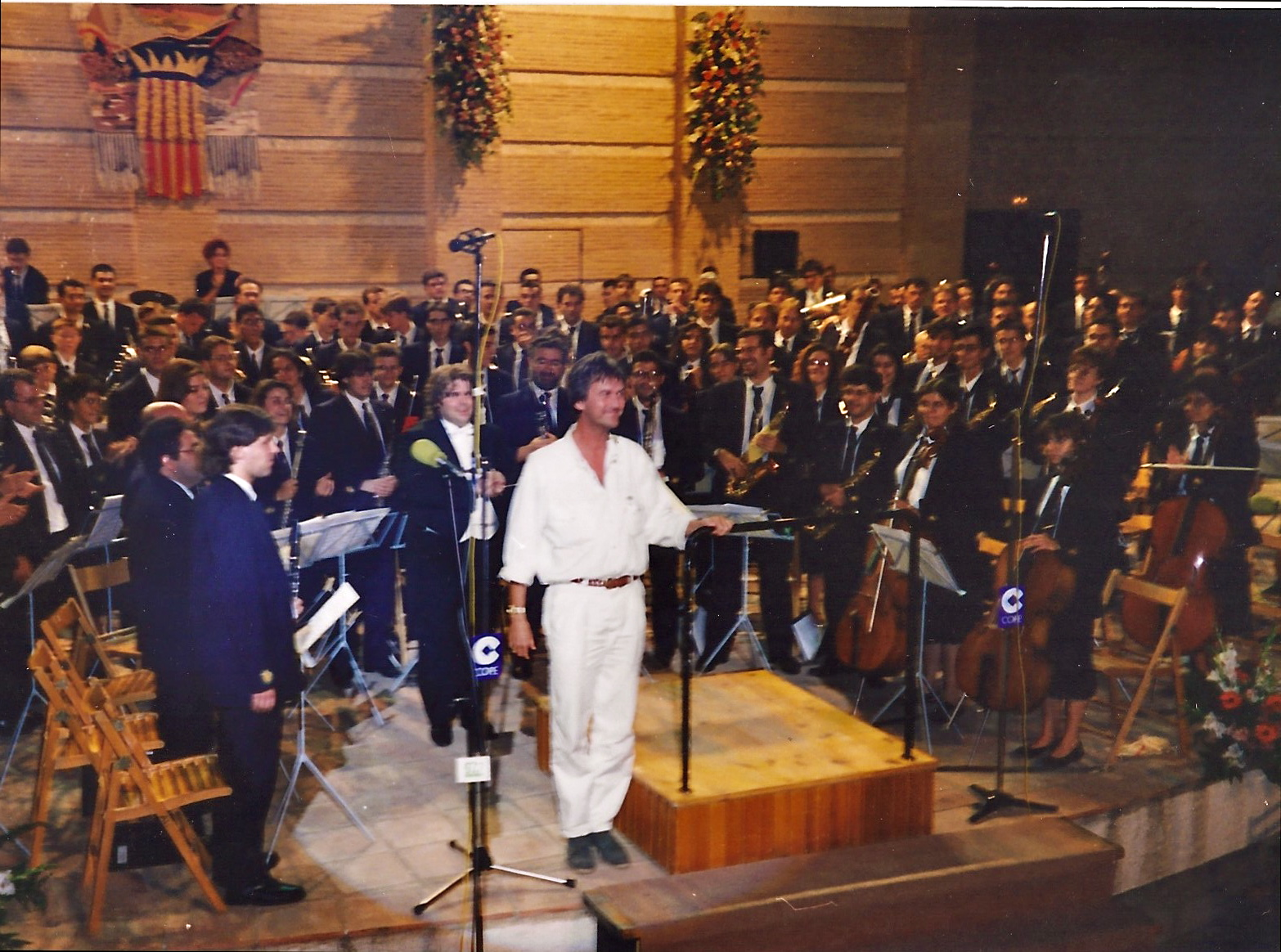 The Spanish première of The Big Apple in Buñol, Spain - August 1995. Performed by La Artistica Buñol, conducted by Maestro Henrie Adams, during the famous annual 'Mano a Mano' concert in the outdoor auditorium San Luis, Buñol.